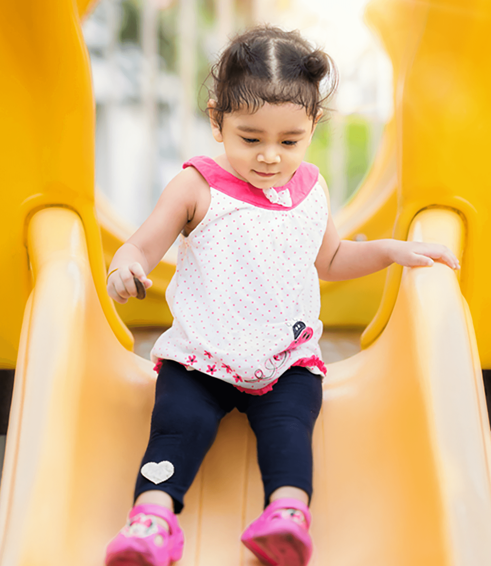 A young girl on a slide