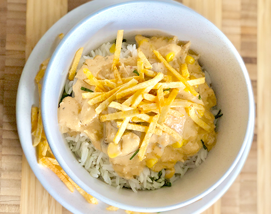 A white plate with a generous helping of Brazilian style chicken stroganoff
