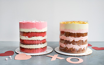 Two pull-up cakes sitting side-by-side on a table.