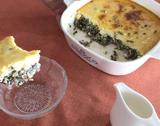 A white and blue Corningware dish filled with wild rice pudding.