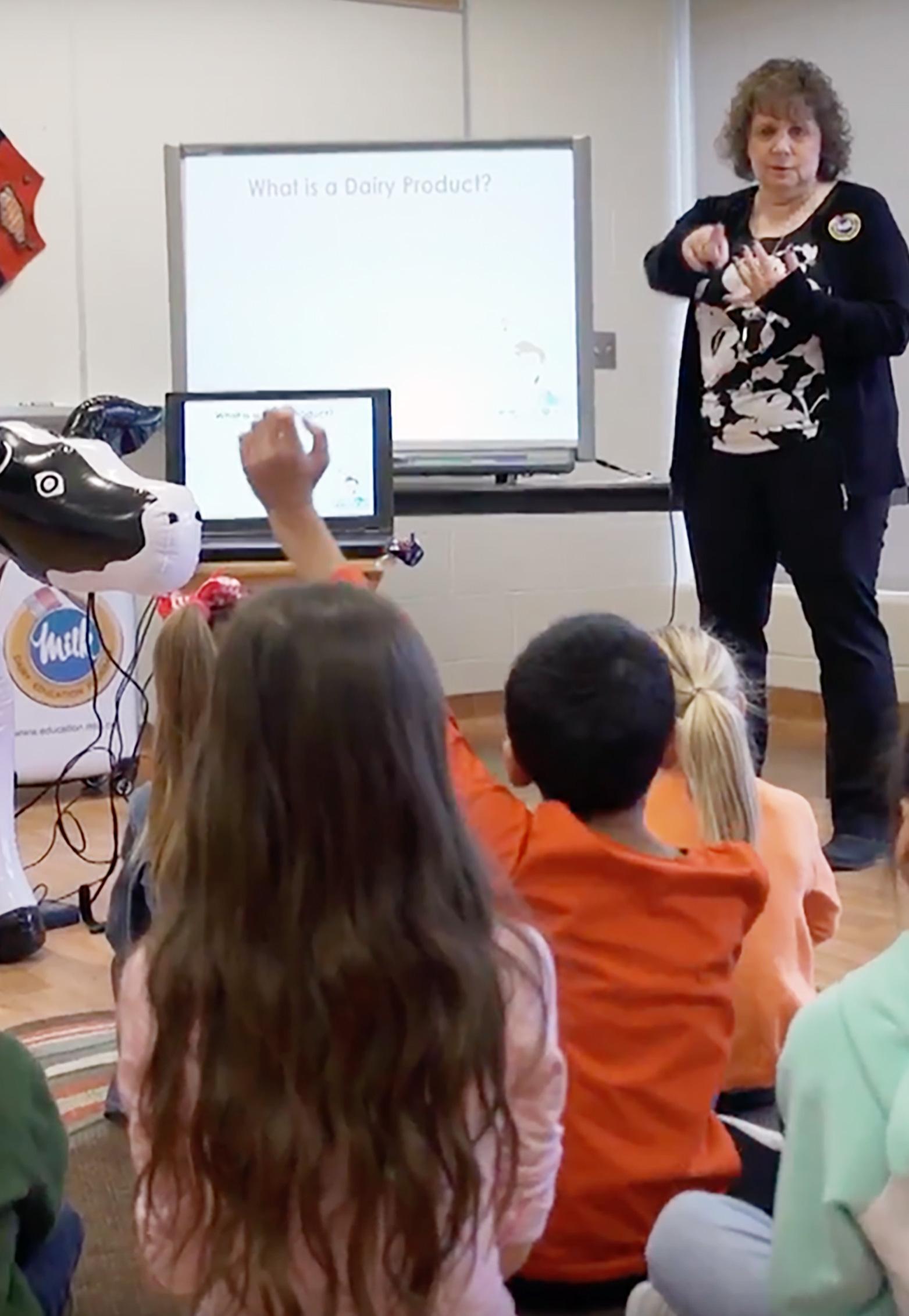 A teacher leads an elementary school class