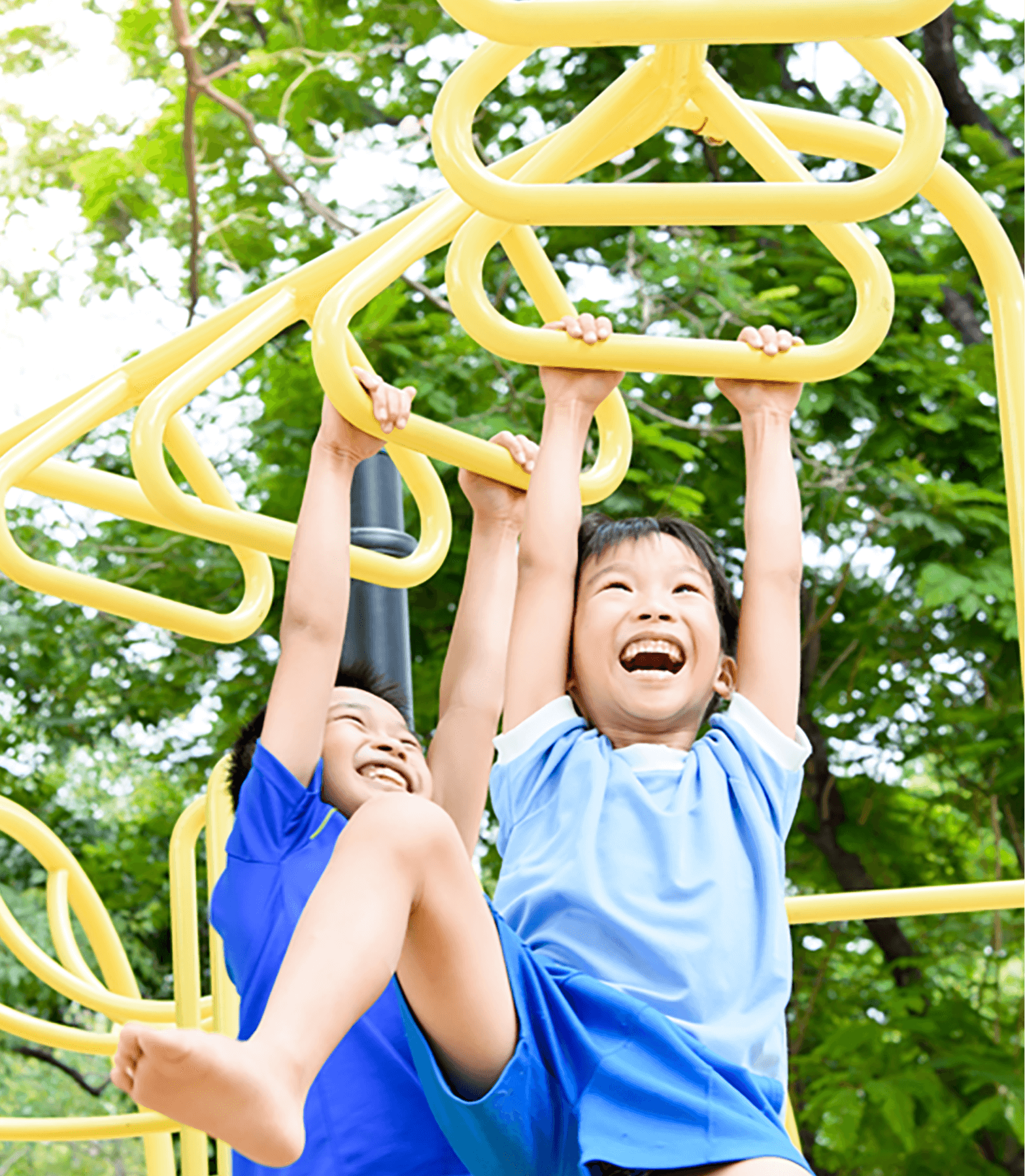 Two young boys climbing on playground equipment