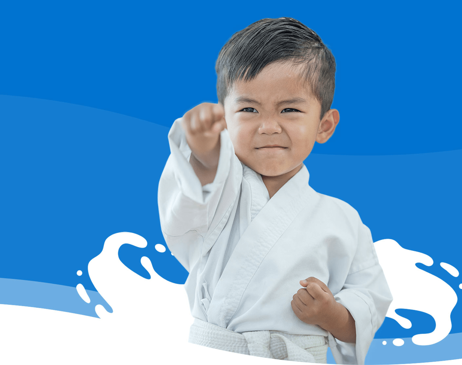 A young boy in a martial arts pose